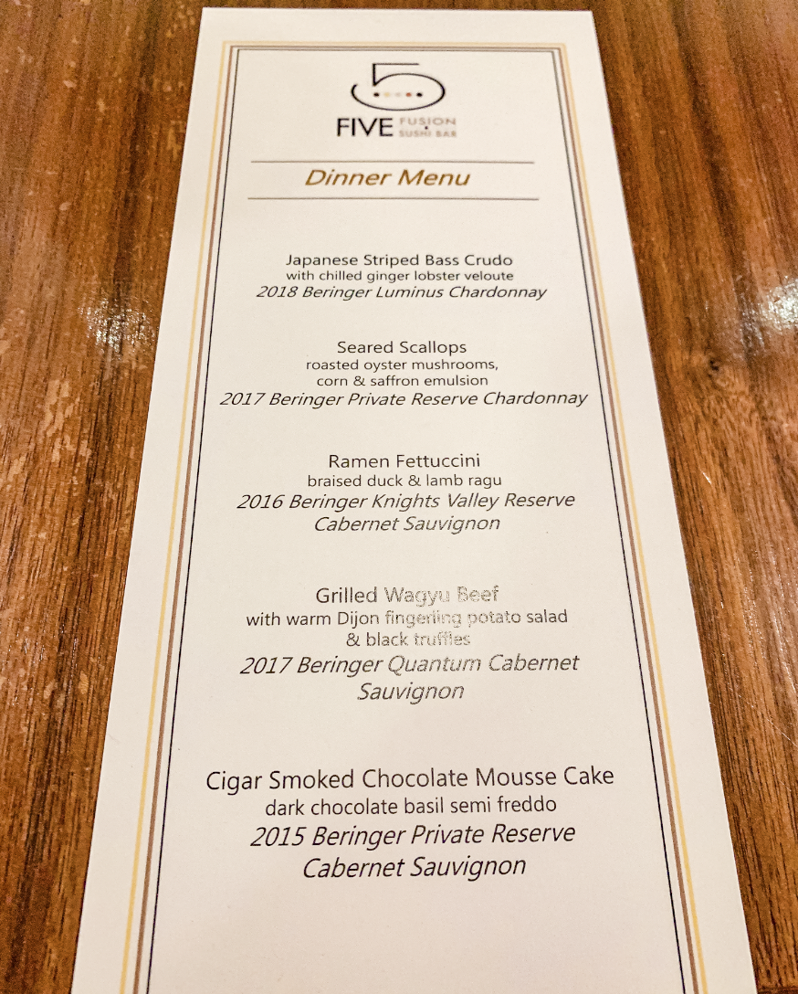 Menu on table showcases the wine pairings set for the Bend and sonoma wine dinner