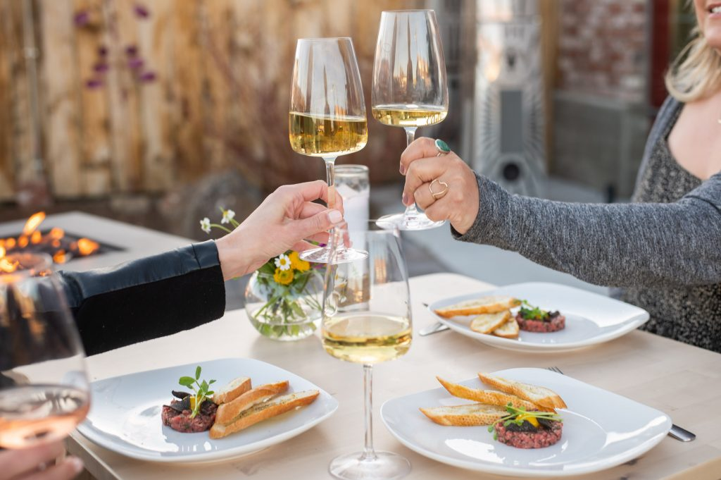 Two glasses of Chardonnay cheers over a fine dining experience in Bend Oregon.