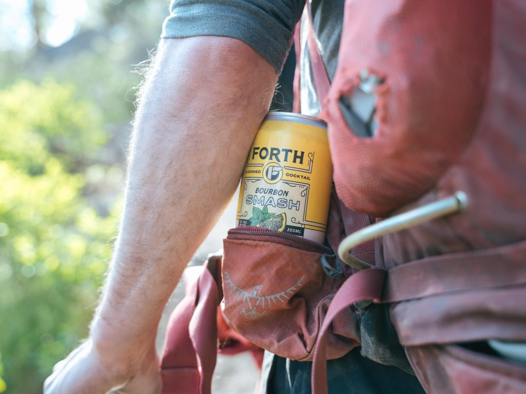 Man carries Forth brand canned cocktail while hiking in Bend Oregon